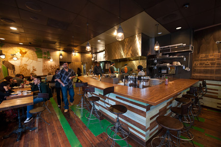 The interior of Glaze is outfitted with reclaimed wood and the original wooden floors.