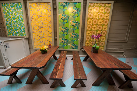 The back patio at Glaze is enlivened with panels of vintage wallpaper.