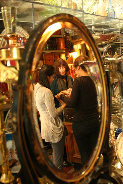 Adele Pomeroy shows customers the shop's collection of estate jewelry.