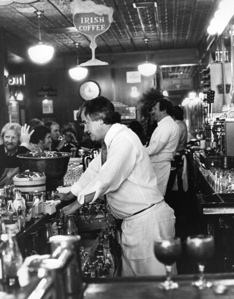 Legendary bartender Michael McCourt behind the bar at Perry's in the 1970s.