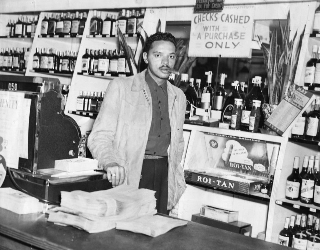 George Hall, Charles Sullivan's brother-in-law, inside the Post Street Liquor Store. Photograph courtesy of the Hall family.