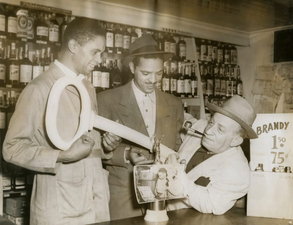 Charles Sullivan also owned the Post Street Liquor Co., which was run by his brother-in-law George Hall (center, with Sullivan's key to the city). Photograph courtesy of the Hall family.