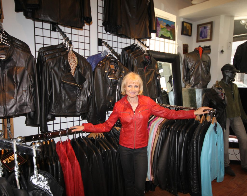 Susanne Rundberg shows off Fog City Leather's selection of custom jackets.