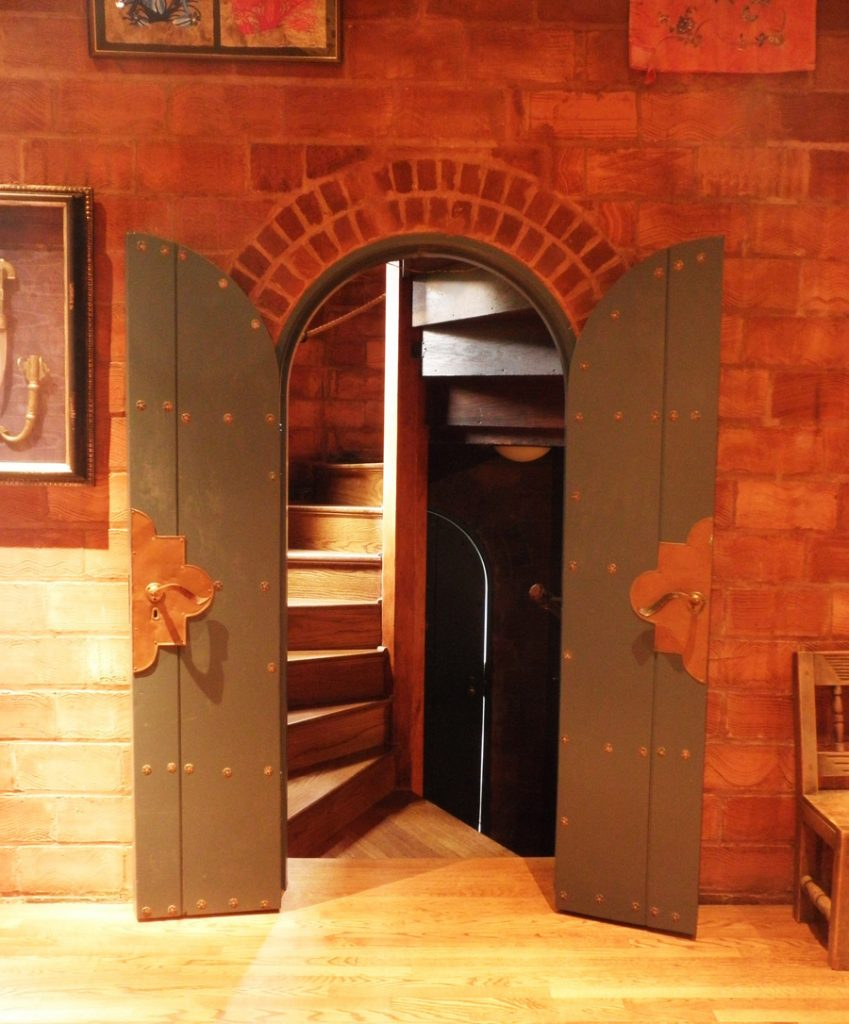 The doorway to the turret features copperwork by Digby Brooks.