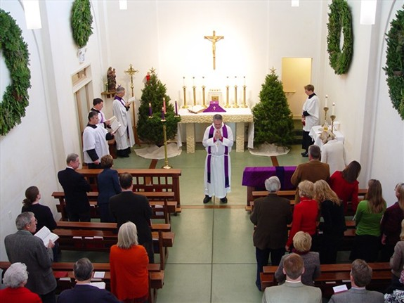 Archbishop James Provence celebrating mass at St. Thomas Church.