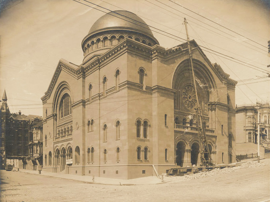 A photograph taken just after the 1906 earthquake shows the damage to the new Temple Sherith Israel. Both 2014 and 2018 Webster are visible behind the temple. In the background is Cooper Medical College.