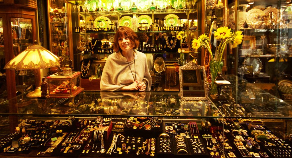 Adele Pomeroy shows antique jewelry at Mureta's Antiques.