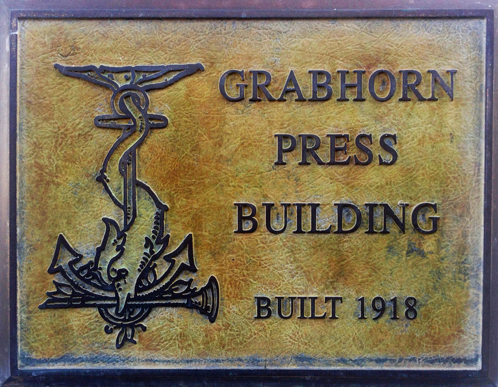 A plaque at 1335 Sutter Street notes the building's history.