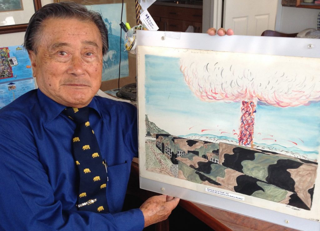 Jack Dairiki with his painting of Hiroshima 30 seconds after the atomic bomb exploded.