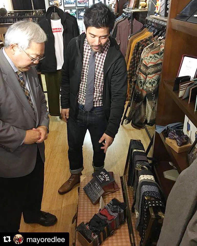 Asmbly Hall's Ron Benitez (center) offers Mayor Ed Lee fashion advice