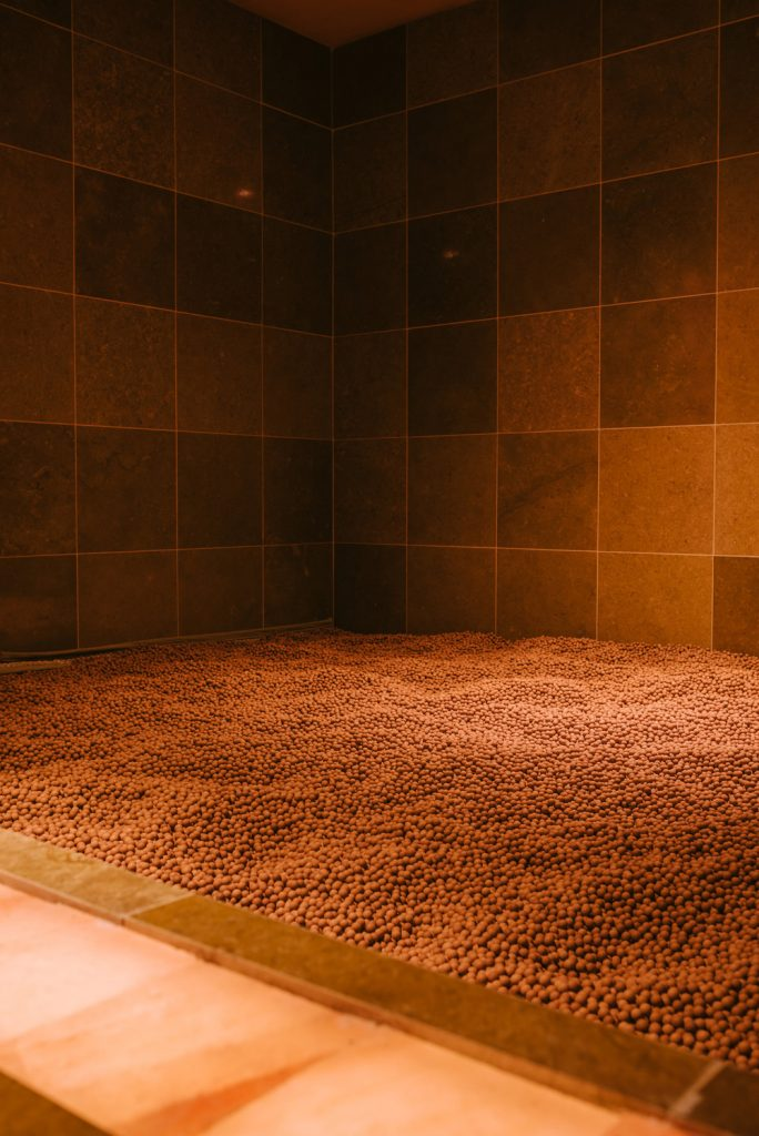 The Clay Room is filled with marble-sized balls of red clay.