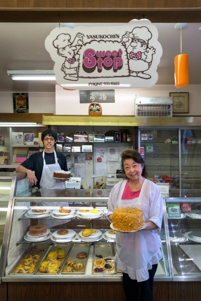 Sweet Stop co-owner Hatsy Yasukochi and her grandson Kenji Yick — and the legendary Coffee Crunch Cake.